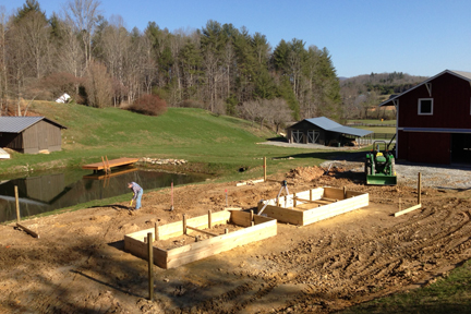 Two of four raised garden beds take shape at Camp Illahee's farm.