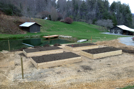 Four raised beds under construction at Camp Illahee's farm.